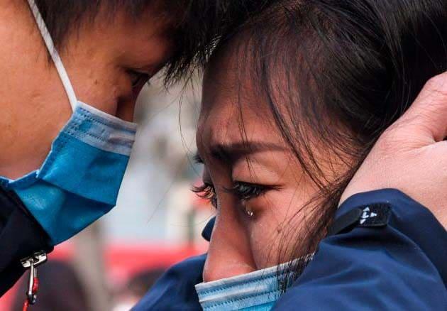 (200129) -- BEIJING, Jan. 29, 2020 (Xinhua) -- Lyu Jun (L), a member of a medical team leaving for Wuhan of Hubei Province, says goodbye to his family at Xinjiang Medical University in Urumqi, northwest China's Xinjiang Uygur Autonomous Region, Jan. 28, 2020. (Xinhua/Wang Fei) (Photo by Xinhua/Sipa USA)